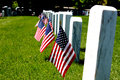 Gravestone with us flags standing front Royalty Free Stock Image