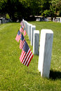 Gravestone with us flags standing front Stock Photography