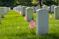 Gravestones and us flags in arlington national cemetery washington dc with during memorial day near to Stock Image