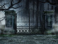 Graveyard gate with trees Royalty Free Stock Photo
