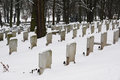 Graveyard in the winter on a snowy day Royalty Free Stock Photos
