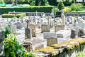 Graveyards and moss french graveyard by church full of Royalty Free Stock Images