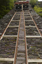 Gravity incline restored with trucks mounted on rails originally for taking slate from quarry Royalty Free Stock Images