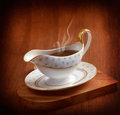 Gravy boat rich steaming served in on wooden board Stock Images