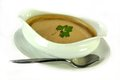Gravy bowl in a with parsley and a spoon Royalty Free Stock Images