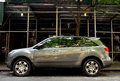 Gray acura mdx with scaffolding as the background Royalty Free Stock Photos