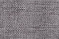 Gray background with braided checkered pattern, closeup. Texture of the weaving fabric, macro. Royalty Free Stock Photo