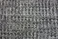 Gray texture of a piece of cloth made of wool Royalty Free Stock Photo