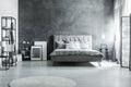 Gray bedding and soft headboard Royalty Free Stock Photo