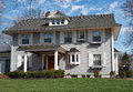 Gray Colonial Type House Royalty Free Stock Photo