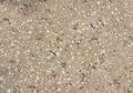 Gray concrete texture closeup with small stones Stock Photos