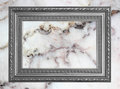 Gray frame Vintage photo frame on marble stone wall background Royalty Free Stock Photo