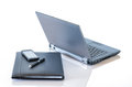 Gray laptop and portfolio for business technology themes Royalty Free Stock Image