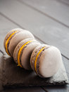 Gray macaroons on dark grey background Royalty Free Stock Photo