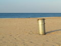 Gray metal garbage bin or can on beach old trash outdoor Royalty Free Stock Images