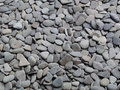 Gray pebble roughness scree stone surface Stock Photo