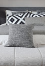 Gray pillow on bench with monotone bedding Royalty Free Stock Photo