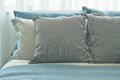 Gray pillows setting on blue color scheme bedding at home Royalty Free Stock Photo