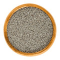 Gray poppy seeds in wooden bowl over white Royalty Free Stock Photo