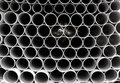 Gray PVC tubes plastic pipes stacked in rows Royalty Free Stock Images