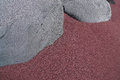 Gray rocks in the reddish sand detail shot of two which lay fine Royalty Free Stock Image