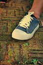 Gray sneakers accessories and wearable sneakers Stock Photos