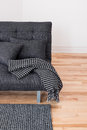 Gray sofa with cushions and throw Stock Photography