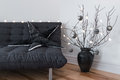 Gray sofa, winter decorations and cozy lights Royalty Free Stock Photography