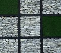Gray stone block and green artificial grass block. Royalty Free Stock Photo