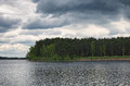 Gray storm clouds over the forest and lake. Pisochne ozero. Volyn region. Ukraine Royalty Free Stock Photo