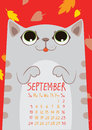 stock image of  Gray striped cute cat under falling leaves. September calendar