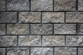 Gray wall of granite bricks texture Royalty Free Stock Photo
