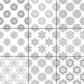 Gray and white floral ornaments. Collection of seamless patterns