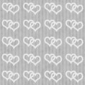 Gray and white interlocking hearts and stripes textured fabric b background that is seamless repeats Stock Photos