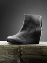 Gray woman boots on the wooden box Stock Image