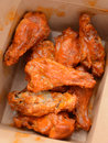 Greasy buffalo chicken wings in takeout container Stock Photos