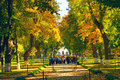 Great autumnal park and people in excursion in historical estate of Kachanivka