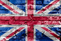 Great Britain flag painted on a brick wall. Flag of United Kingdom. Textured abstract background Royalty Free Stock Photo