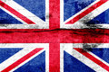 Great Britain flag painted on a weathered wooden board. Flag of United Kingdom. Textured abstract background Royalty Free Stock Photo