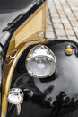 Great detail with the front light of a vintage car beautiful yellow black Stock Images