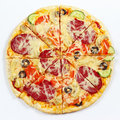 Great flavorful pizza sliced into chunks on white background a Stock Photography