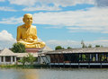 The Great Golden statue Monk at Puttha Utthayan Maharat Buddha Park Royalty Free Stock Photo