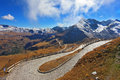 Great highway winds between hillsides austrian alps excursion to the picturesque panoramic way grossgloknershtrasse sunny day in Stock Image