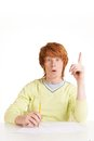 Great idea portrait of redhead student pointing upwards and looking at camera Stock Photography
