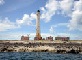 Great isaac cay lighthouse in the bahamas surrounded by abandoned homes on coast Stock Images
