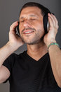 Great music moment smiling man listening to with passion Stock Images