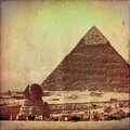 The great pyramid and sphinx in grunge Royalty Free Stock Image