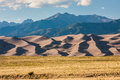 Great sand dunes national park view of and preserve from entrance road sangre de cristo mountains in the background late afternoon Royalty Free Stock Images