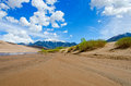 Great sand dunes river bed at the with the colorado rocky mountains in the background Royalty Free Stock Photo