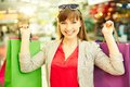 Great shopping portrait of satisfied girl holding colorful bags Stock Photography